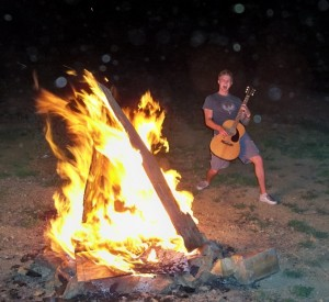 Playing the Guit Next to a Fire